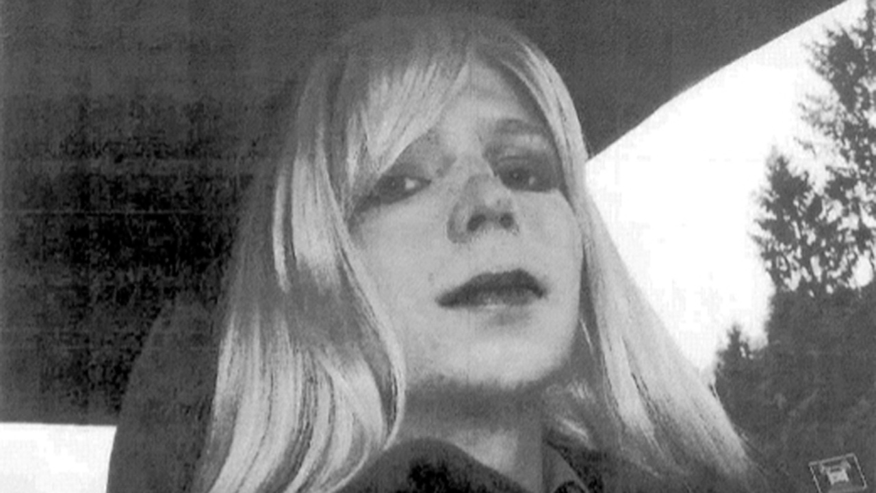 In this undated file photo provided by the U.S. Army, Pfc. Bradley Manning poses for a photo wearing a wig and lipstick. Manning later transitioned to being a woman named Chelsea.