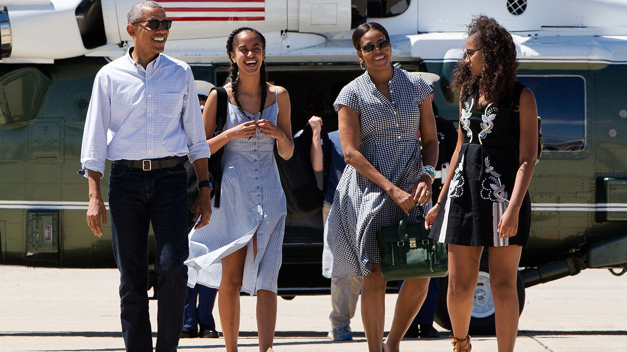 President Barack Obama, Malia Obama, first lady Michelle Obama, and Sasha Obama walk to Air Force One after leaving Yosemite National Park on Sunday, June 19, 2016.