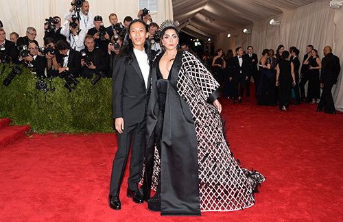 <div class='meta'><div class='origin-logo' data-origin='AP'></div><span class='caption-text' data-credit='Evan Agostini/Invision/AP'>Alexander Wang, left, and Lady Gaga arrive at The Metropolitan Museum of Art's Costume Institute benefit gala celebrating &#34;China: Through the Looking Glass&#34; on Monday, May 4, 2015.</span></div>