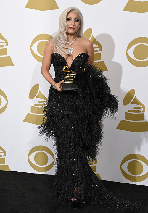 <div class='meta'><div class='origin-logo' data-origin='AP'></div><span class='caption-text' data-credit='Chris Pizzello/Invision/AP'>Lady Gaga poses in the press room with the award for best traditional pop vocal album for &#34;Cheek to Cheek&#34; at the 57th annual Grammy Awards on Sunday, Feb. 8, 2015, in Los Angeles.</span></div>