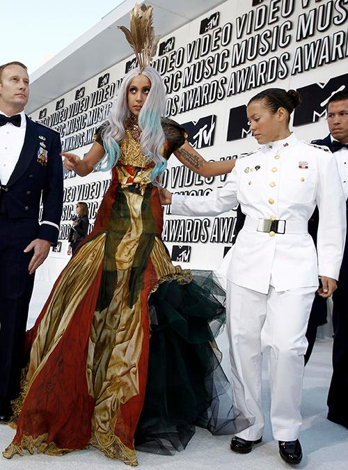 <div class='meta'><div class='origin-logo' data-origin='AP'></div><span class='caption-text' data-credit='AP Photo/Matt Sayles'>Lady Gaga, center, arrives at the MTV Video Music Awards on Sunday, Sept. 12, 2010 in Los Angeles.</span></div>