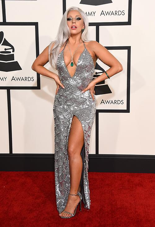 <div class='meta'><div class='origin-logo' data-origin='AP'></div><span class='caption-text' data-credit='Jordan Strauss/Invision/AP'>Lady Gaga arrives at the 57th annual Grammy Awards at the Staples Center in Los Angeles wearing a silver gown with a plunging neckline and high slit.</span></div>