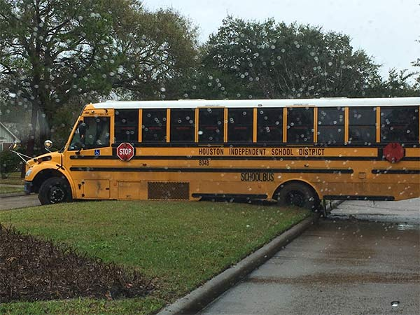 <div class='meta'><div class='origin-logo' data-origin='none'></div><span class='caption-text' data-credit='D. Leigh Martin, IV'>HISD school bus stuck on median of street</span></div>