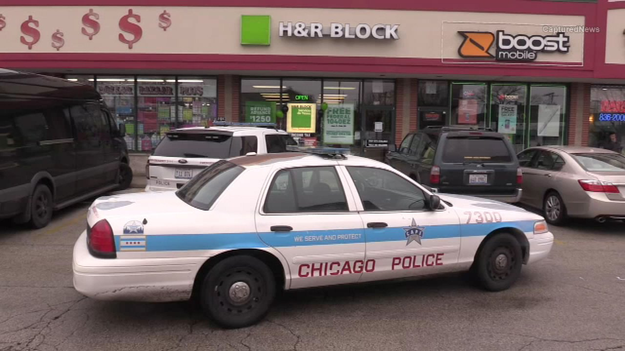 Police are investigating a reported armed robbery at an H&R Block office on Chicago's West Side Wednesday morning.