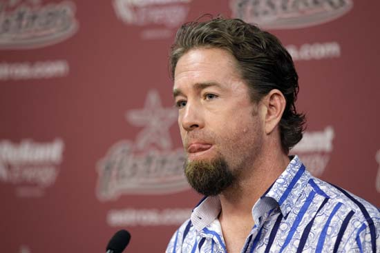 <div class='meta'><div class='origin-logo' data-origin='AP'></div><span class='caption-text' data-credit='David J. Phillip'>Houston Astros' hitting coach Jeff Bagwell listens to a question during a news conference announcing his new position with the team.</span></div>