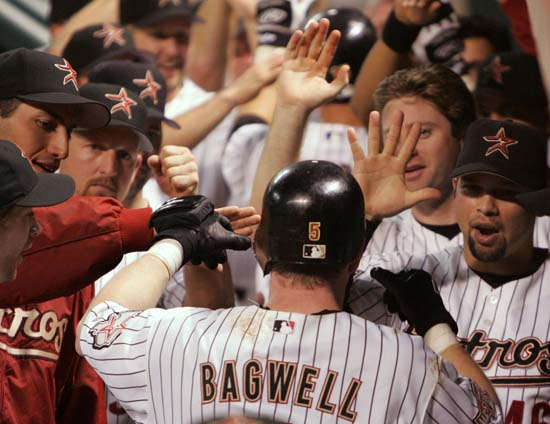 <div class='meta'><div class='origin-logo' data-origin='AP'></div><span class='caption-text' data-credit='David J. Phillip'>Houston Astros' Jeff Bagwell is congratulated by teammates, including Andy Pettitte, left, and Raul Chavez (46) after hitting a two-run home run against the Colorado Rockies.</span></div>