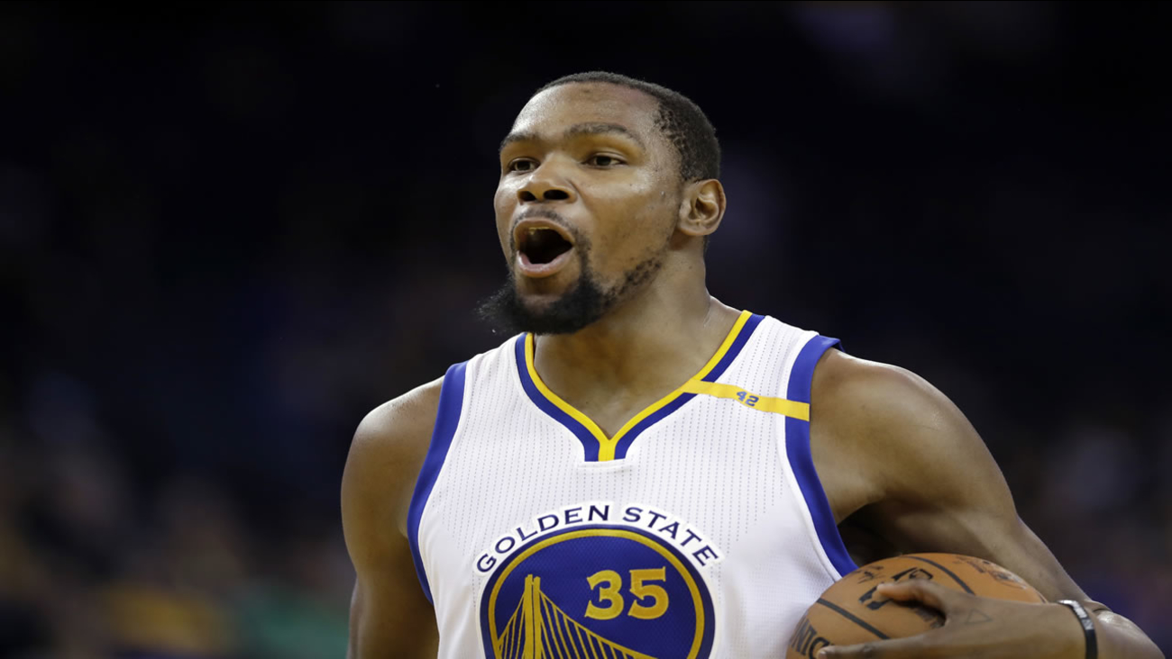 Golden State Warriors' Kevin Durant (35) reacts to a foul call during the second half of an NBA basketball game against the Miami Heat Tuesday, Jan. 10, 2017, in Oakland, Calif.