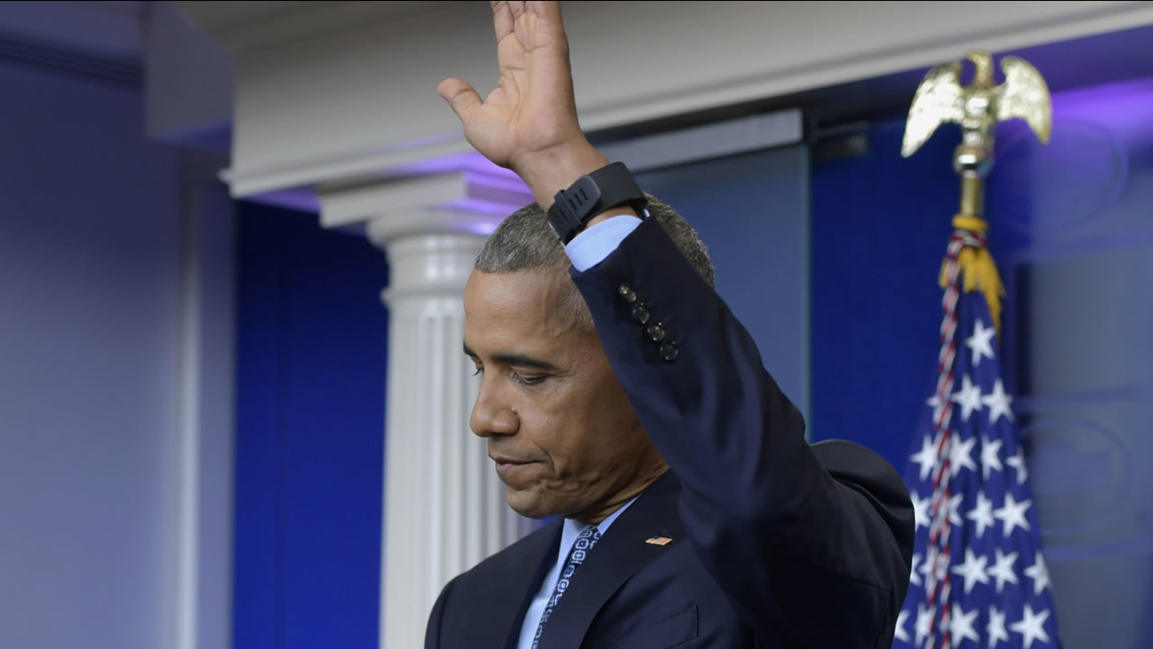 President Obama waves at the conclusion of his final presidential news conference, Wednesday, Jan. 18, 2017, in the Brady Press Briefing Room of the White House in Washington.