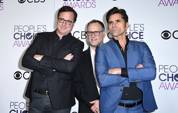 """<div class=""""meta image-caption""""><div class=""""origin-logo origin-image none""""><span>none</span></div><span class=""""caption-text"""">Bob Saget, Dave Coulier, and John Stamos, winners of the award for favorite premium comedy series for """"Fuller House,"""" pose in the press room at the People's Choice Awards. (Jordan Strauss/Invision/AP)</span></div>"""