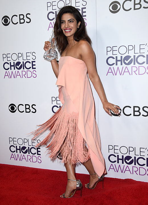 """<div class=""""meta image-caption""""><div class=""""origin-logo origin-image none""""><span>none</span></div><span class=""""caption-text"""">Priyanka Chopra poses in the press room with the award for favorite TV drama actress at the People's Choice Awards at the Microsoft Theater on Wednesday, Jan. 18, 2017. (Jordan Strauss/Invision/AP)</span></div>"""