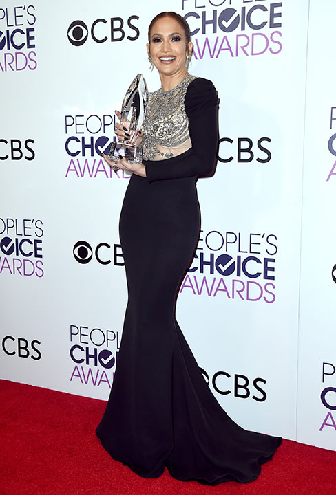 """<div class=""""meta image-caption""""><div class=""""origin-logo origin-image none""""><span>none</span></div><span class=""""caption-text"""">Jennifer Lopez poses in the press room with the award for favorite TV crime drama actress at the People's Choice Awards at the Microsoft Theater on Wednesday, Jan. 18, 2017. (Jordan Strauss/Invision/AP)</span></div>"""