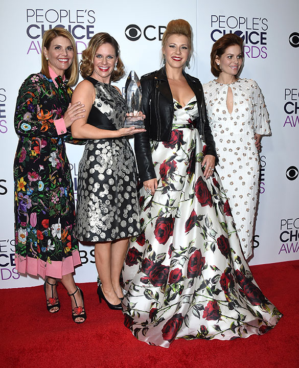 """<div class=""""meta image-caption""""><div class=""""origin-logo origin-image none""""><span>none</span></div><span class=""""caption-text"""">Lori Loughlin, from left, Andrea Barber, Jodie Sweetin, and Candace Cameron-Bure pose in the press room with the award for favorite premium comedy series for ''Fuller House.'' (Jordan Strauss/Invision/AP)</span></div>"""