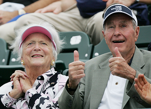 <div class='meta'><div class='origin-logo' data-origin='AP'></div><span class='caption-text' data-credit='(AP Photo/David J. Phillip'>Former President George Bush, right,  gives a thumbs up while he and  his wife, Barbara, left, attend the Tennis Masters Cup tournament Tuesday, Nov. 16, 2004 in Houston.</span></div>
