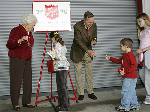 <div class='meta'><div class='origin-logo' data-origin='AP'></div><span class='caption-text' data-credit='AP Photo/David J. Phillip'>Former president George H.W. Bush, center, and former first lady Barbara Bush, left, ring a bell for the Salvation Army Monday, Dec. 18, 2006, in Houston.</span></div>
