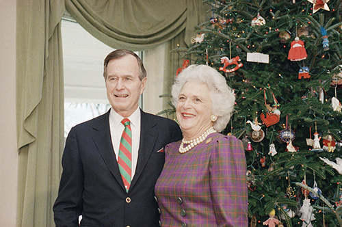 <div class='meta'><div class='origin-logo' data-origin='AP'></div><span class='caption-text' data-credit='AP'>Vice President George H.W. Bush poses with wife Barbara by the White House Christmas tree, Dec., 1988.</span></div>
