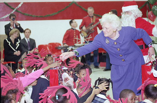 <div class='meta'><div class='origin-logo' data-origin='AP'></div><span class='caption-text' data-credit='AP Photo/Barry Thumma'>First Lady Barbara Bush, right, at a Toys for Tots Christmas party at the Metropolitan Police Boys and Girls Club, Wednesday, Dec. 9, 1992, Washington, D.C.</span></div>