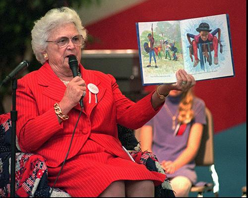 <div class='meta'><div class='origin-logo' data-origin='AP'></div><span class='caption-text' data-credit='AP Photo/Scott Troyanos'>Barbara Bush holds up the children's book, &#34;Amazing Grace,&#34; as she reads to the elementary students during the 1996 dedication ceremonies of Barbara Bush Elementary School.</span></div>