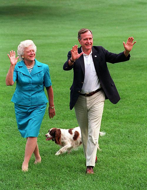 <div class='meta'><div class='origin-logo' data-origin='AP'></div><span class='caption-text' data-credit='AP Photo/Scott Applewhite, File'>President and Mrs. Bush walk with Millie across the South Lawn as they return to the White House in an Aug. 24, 1992, file photo.</span></div>