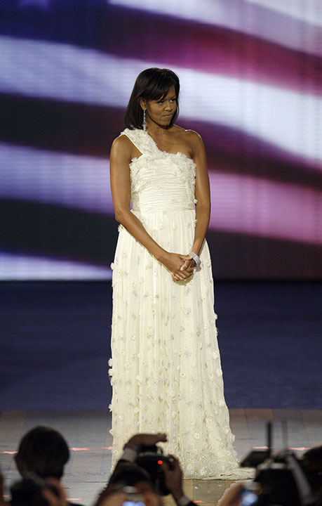 "<div class=""meta image-caption""><div class=""origin-logo origin-image none""><span>none</span></div><span class=""caption-text"">First lady Michelle Obama acknowledges applause as she arrives at the Neighborhood Inaugural Ball in Washington, Tuesday, Jan. 20, 2009. (Alex Brandon/AP Photo)</span></div>"