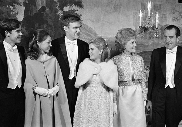 "<div class=""meta image-caption""><div class=""origin-logo origin-image none""><span>none</span></div><span class=""caption-text"">President Nixon, right, and his family prepare to leave the White House to attend six inaugural balls, in Washington, D.C., Jan. 20, 1969. (AP Photo)</span></div>"