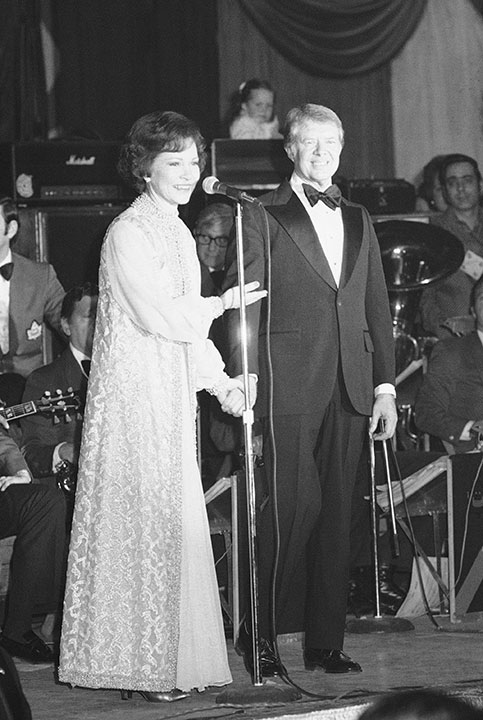 "<div class=""meta image-caption""><div class=""origin-logo origin-image none""><span>none</span></div><span class=""caption-text"">President Jimmy Carter holds his wife Rosalynn's hand as she says a few words at an inaugural party in Washington on Thursday, Jan. 21, 1977. (AP Photo)</span></div>"
