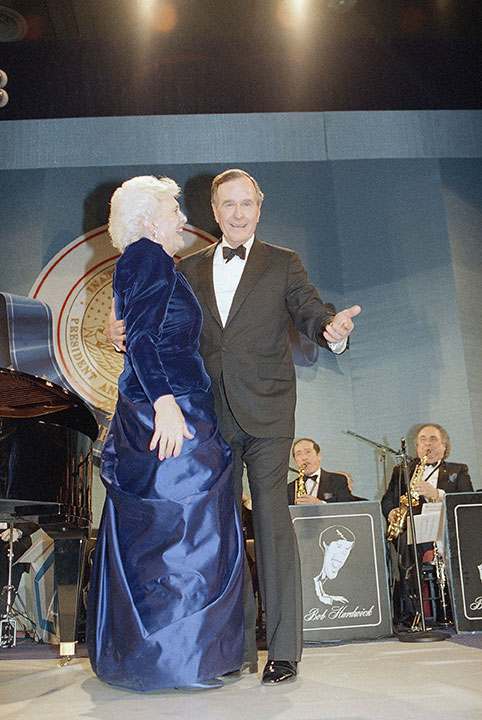 "<div class=""meta image-caption""><div class=""origin-logo origin-image none""><span>none</span></div><span class=""caption-text"">U.S. President and Mrs. Bush dance during an inaugural ball at the Washington Convention Center at night, Friday, Jan. 21, 1989.</span></div>"
