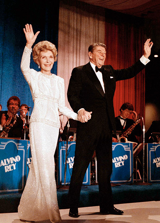 "<div class=""meta image-caption""><div class=""origin-logo origin-image none""><span>none</span></div><span class=""caption-text"">In this Jan. 21, 1985 file photo, President Ronald Reagan and first lady Nancy Reagan arrive at the inaugural ball in the Washington Hilton. (Ira Schwarz/AP Photo)</span></div>"