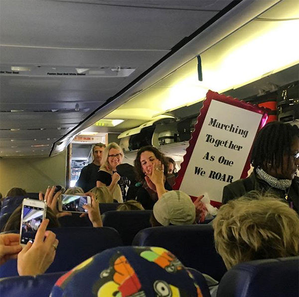 "<div class=""meta image-caption""><div class=""origin-logo origin-image none""><span>none</span></div><span class=""caption-text"">""En route to the women's march in DC! This gal got quite the applause as she boarded"" (@taskered)</span></div>"