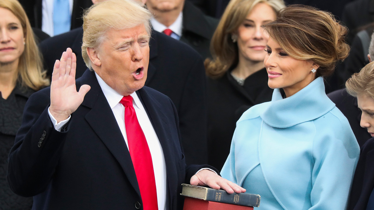Donald Trump is sworn in as the 45th president of the United States as Melania Trump looks on during at the U.S. Capitol in Washington, Friday, Jan. 20, 2017.