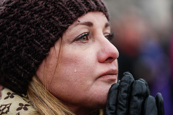 <div class='meta'><div class='origin-logo' data-origin='none'></div><span class='caption-text' data-credit='John Minchillo/AP Photo'>Cheryl Edmondson cries as President-elect Donald Trump appears for his inauguration, Friday, Jan. 20, 2017, in Washington.</span></div>