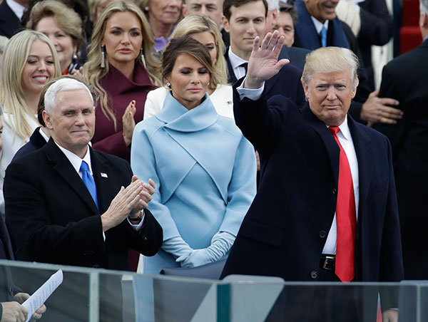<div class='meta'><div class='origin-logo' data-origin='none'></div><span class='caption-text' data-credit='Patrick Semansky/AP Photo'>President-elect Donald Trump waves with Vice President-elect Mike Pence and his wife Melania Trump before the 58th Presidential Inauguration at the U.S. Capitol in Washington.</span></div>
