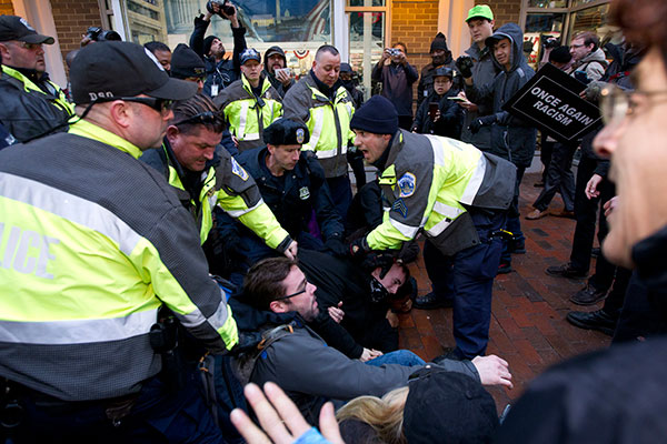 "<div class=""meta image-caption""><div class=""origin-logo origin-image none""><span>none</span></div><span class=""caption-text"">Police try to remove demonstrators from attempting to block people entering a security checkpoint, Friday, Jan. 20, 2017. (Jose Luis Magana/AP Photo)</span></div>"