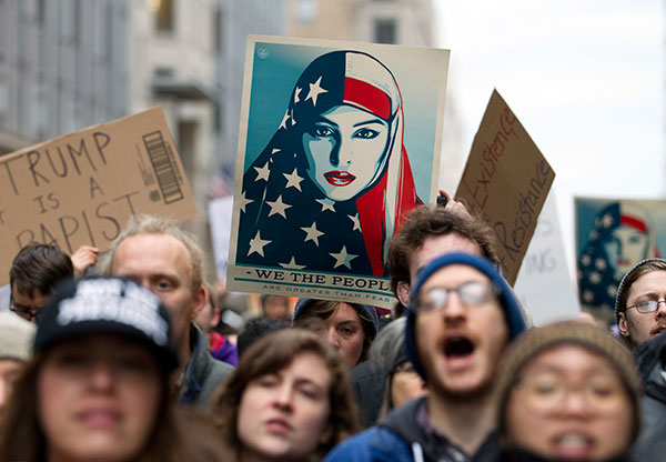 "<div class=""meta image-caption""><div class=""origin-logo origin-image none""><span>none</span></div><span class=""caption-text"">Demonstrators march on the street near a security checkpoint inaugural entrance, Friday, Jan. 20, 2017 in Washington (Jose Luis Magana/AP Photo)</span></div>"