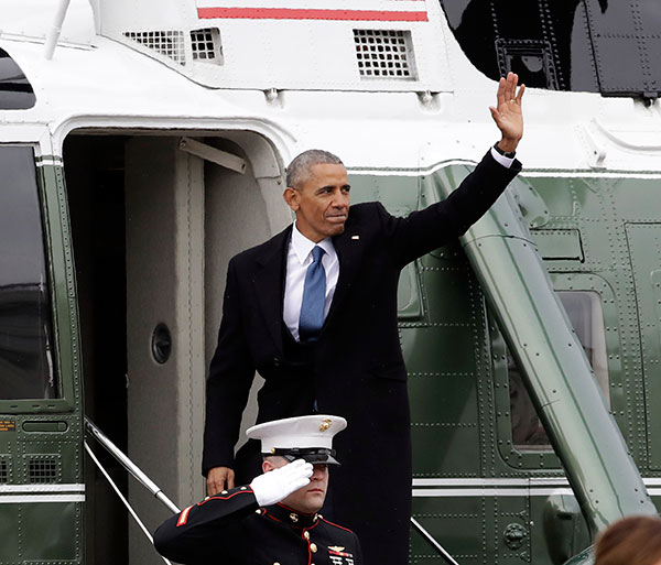 <div class='meta'><div class='origin-logo' data-origin='none'></div><span class='caption-text' data-credit='Evan Vucci/AP Photo'>Former President Barack Obama waves as he boards a Marine helicopter during a departure ceremony on the East Front of the U.S. Capitol in Washington, Friday, Jan. 20, 2017.</span></div>