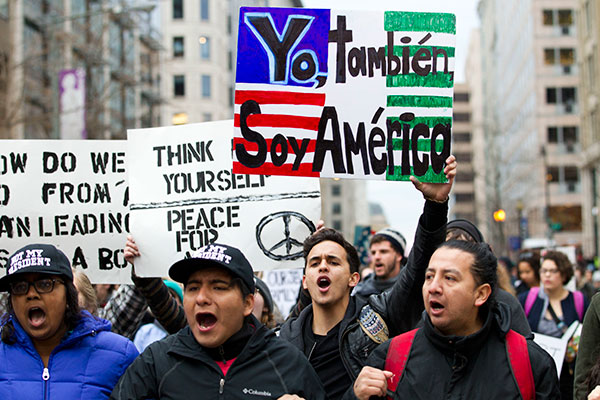"<div class=""meta image-caption""><div class=""origin-logo origin-image none""><span>none</span></div><span class=""caption-text"">Demonstrators march on the street near a security checkpoint inaugural entrance, Friday, Jan. 20, 2017 in Washington. (Jose Luis Magana/AP Photo)</span></div>"