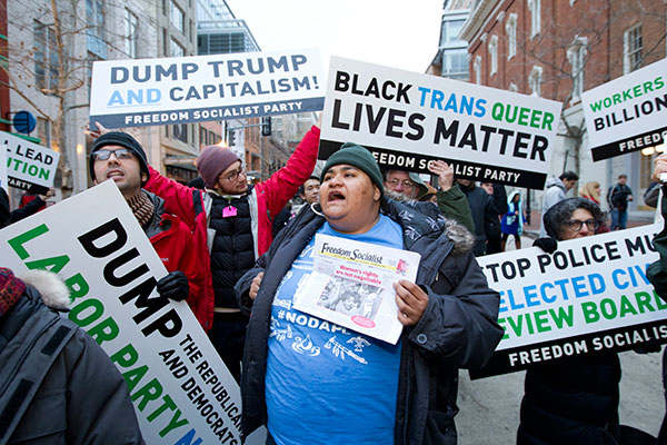 "<div class=""meta image-caption""><div class=""origin-logo origin-image none""><span>none</span></div><span class=""caption-text"">Demonstrators chant near a security checkpoint entrance to the inauguration, Friday, Jan. 20, 2017 in Washington, ahead of President-elect Donald Trump's inauguration. (Jose Luis Magana/AP Photo)</span></div>"