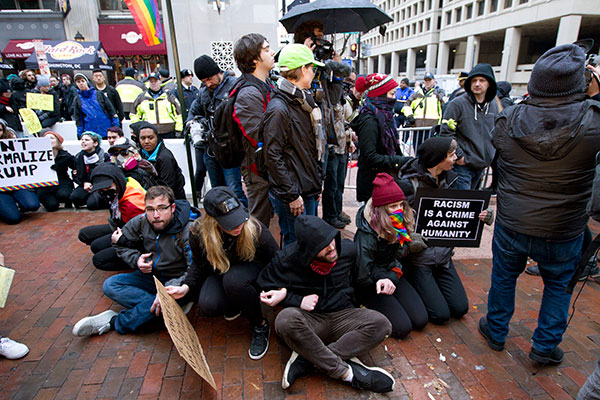 "<div class=""meta image-caption""><div class=""origin-logo origin-image none""><span>none</span></div><span class=""caption-text"">Demonstrators sit on sidewalk attempting to block people entering a security checkpoint, Friday, Jan. 20, 2017, ahead of President-elect Donald Trump's inauguration in Washington. (Jose Luis Magana/AP Photo)</span></div>"