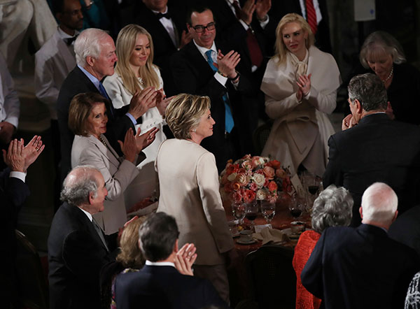 <div class='meta'><div class='origin-logo' data-origin='none'></div><span class='caption-text' data-credit='Manuel Balce Ceneta/AP Photo'>Hillary Clinton stands as she is recognized by President Donald Trump during his speech at the inaugural luncheon at the Statuary Hall in the Capitol, Friday, Jan. 20, 2017</span></div>