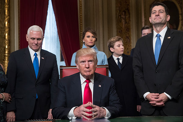 <div class='meta'><div class='origin-logo' data-origin='none'></div><span class='caption-text' data-credit='AP Photo/J. Scott Applewhite, Pool'>President Donald Trump is joined by the Congressional leadership and his family before formally signing his cabinet nominations into law, Friday, Jan. 20, 2107.</span></div>