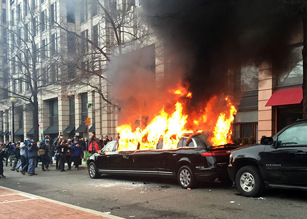 "<div class=""meta image-caption""><div class=""origin-logo origin-image none""><span>none</span></div><span class=""caption-text"">Protesters set a parked limousine on fire in downtown Washington, Friday, Jan. 20, 2017, during the inauguration of President Donald Trump. (Juliet Linderman/AP Photo)</span></div>"