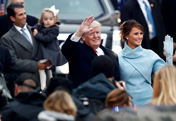 <div class='meta'><div class='origin-logo' data-origin='none'></div><span class='caption-text' data-credit='Carolyn Kaster/AP Photo'>President Donald Trump and first lady Melania Trump walk during the Inauguration Day Parade Route in Washington, Friday, Jan. 20, 2017.</span></div>