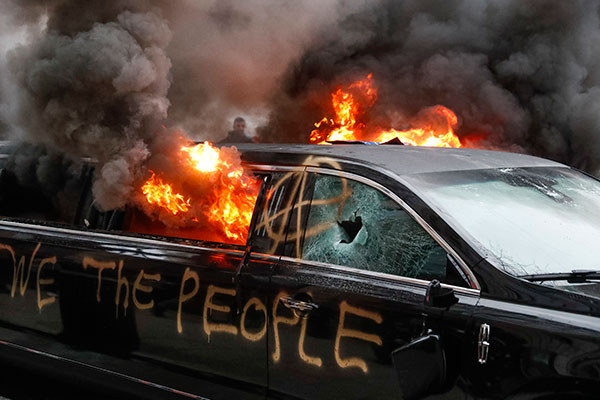 <div class='meta'><div class='origin-logo' data-origin='none'></div><span class='caption-text' data-credit='John Minchillo/AP Photo'>A parked limousine burns during a demonstration after the inauguration of President Donald Trump, Friday, Jan. 20, 2017, in Washington.</span></div>