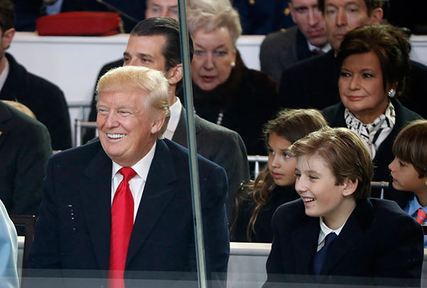 "<div class=""meta image-caption""><div class=""origin-logo origin-image none""><span>none</span></div><span class=""caption-text"">President Donald Trump smiles with his son Barron as they view the 58th Presidential Inauguration parade for President Donald Trump in Washington. Friday, Jan. 20, 2017. (Pablo Martinez Monsivais/AP Photo)</span></div>"