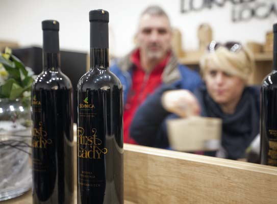 """<div class=""""meta image-caption""""><div class=""""origin-logo origin-image none""""><span>none</span></div><span class=""""caption-text"""">Visitors look at bottles of local wine """"First Lady"""" displayed for visitors in Sevnica, Slovenia, Friday, Jan. 20, 2017.  (AP Photo/Darko Bandic) (AP)</span></div>"""
