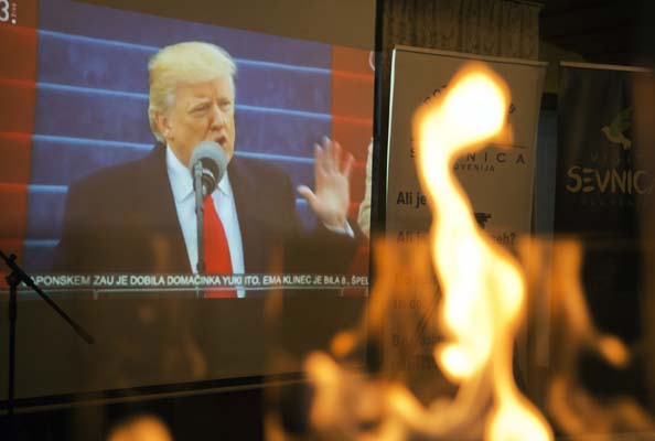 """<div class=""""meta image-caption""""><div class=""""origin-logo origin-image none""""><span>none</span></div><span class=""""caption-text"""">Televised broadcast of Presidential inauguration of Donald Trump is seen from behind a fireplace, at a restaurant in Sevnica, Slovenia, Jan. 20, 2017.  (AP Photo/Darko Bandic) (AP)</span></div>"""