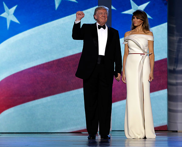 "<div class=""meta image-caption""><div class=""origin-logo origin-image none""><span>none</span></div><span class=""caption-text"">President Donald Trump acknowledges the crowd with first lady Melania Trump at the Freedom Ball, Friday, Jan. 20, 2017, in Washington. (Evan Vucci/AP Photo)</span></div>"