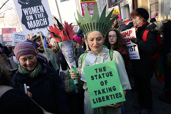 "<div class=""meta image-caption""><div class=""origin-logo origin-image none""><span>none</span></div><span class=""caption-text"">Demonstrators take part in the Women's March on London, following the Inauguration of U.S. President Donald Trump, in London, Saturday Jan. 21, 2017. (Tim Ireland/AP Photo)</span></div>"