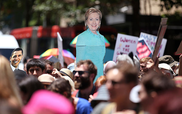 "<div class=""meta image-caption""><div class=""origin-logo origin-image none""><span>none</span></div><span class=""caption-text"">Images of Hillary Clinton and Barack Obama are carried as thousands file through the streets during the Women's March in Sydney, Australia on Saturday. (Rick Rycroft/AP Photo)</span></div>"