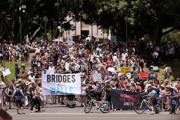 <div class='meta'><div class='origin-logo' data-origin='none'></div><span class='caption-text' data-credit='Rick Rycroft/AP Photo'>People gather at Hyde Park during the Women's March rally protesting the start of Donald Trump's presidency, in Sydney, Australia, Saturday, Jan. 21, 2017.</span></div>