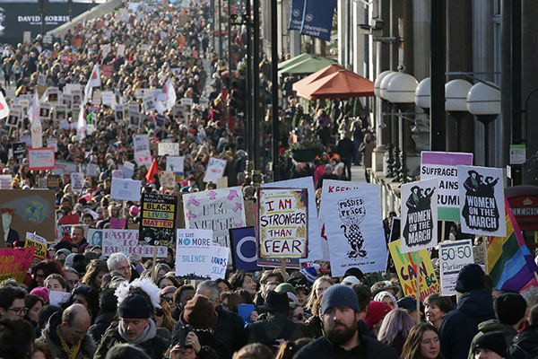 <div class='meta'><div class='origin-logo' data-origin='none'></div><span class='caption-text' data-credit='Tim Ireland/AP Photo'>Demonstrators take part in the Women's March on London, following the Inauguration of U.S. President Donald Trump, in London, Saturday Jan. 21, 2017.</span></div>